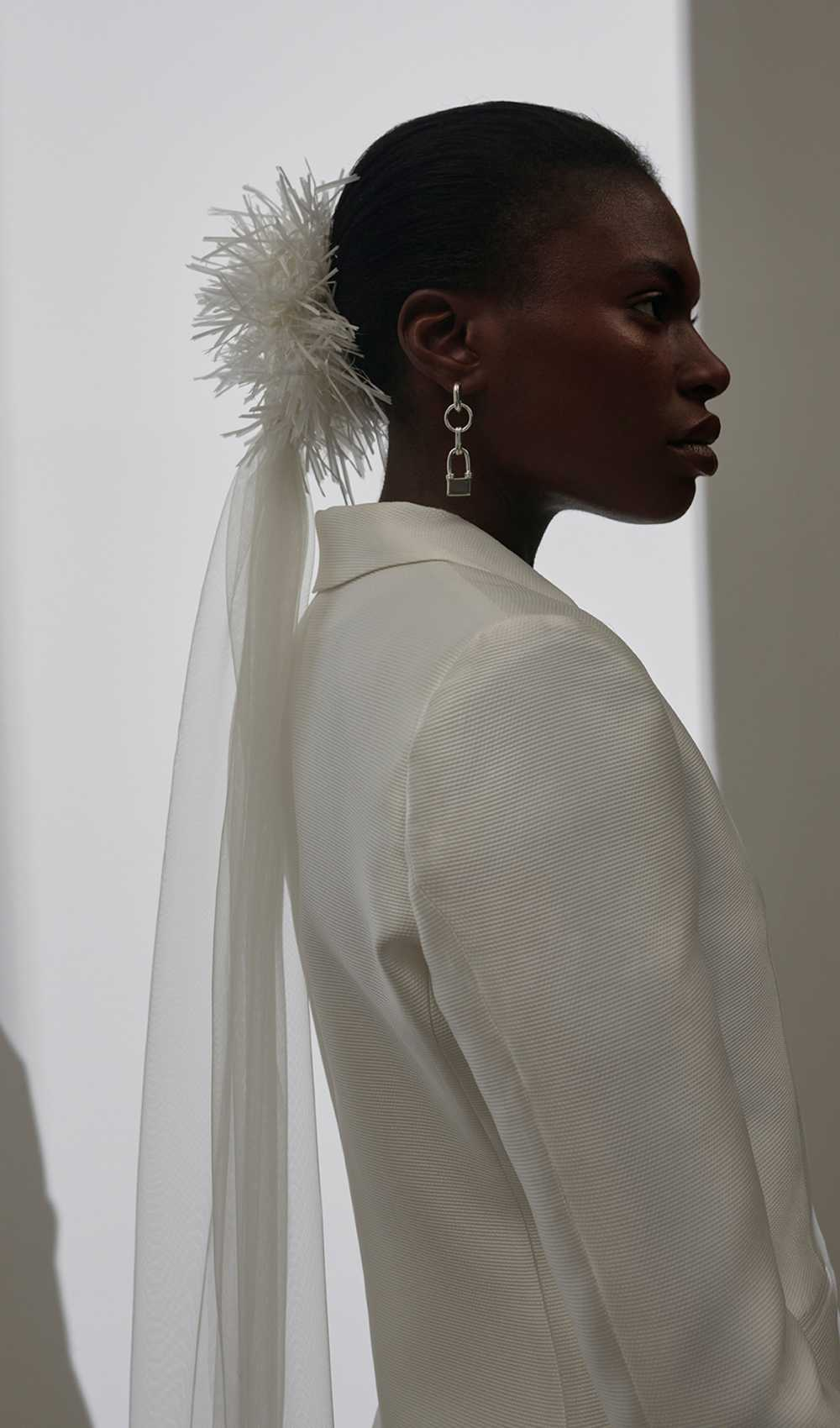 Scrunchy with white tinsel and tulle veil